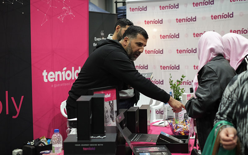 Tenfold Director Bassem, giving Da'wah to 2 women at the Eid Festival stand