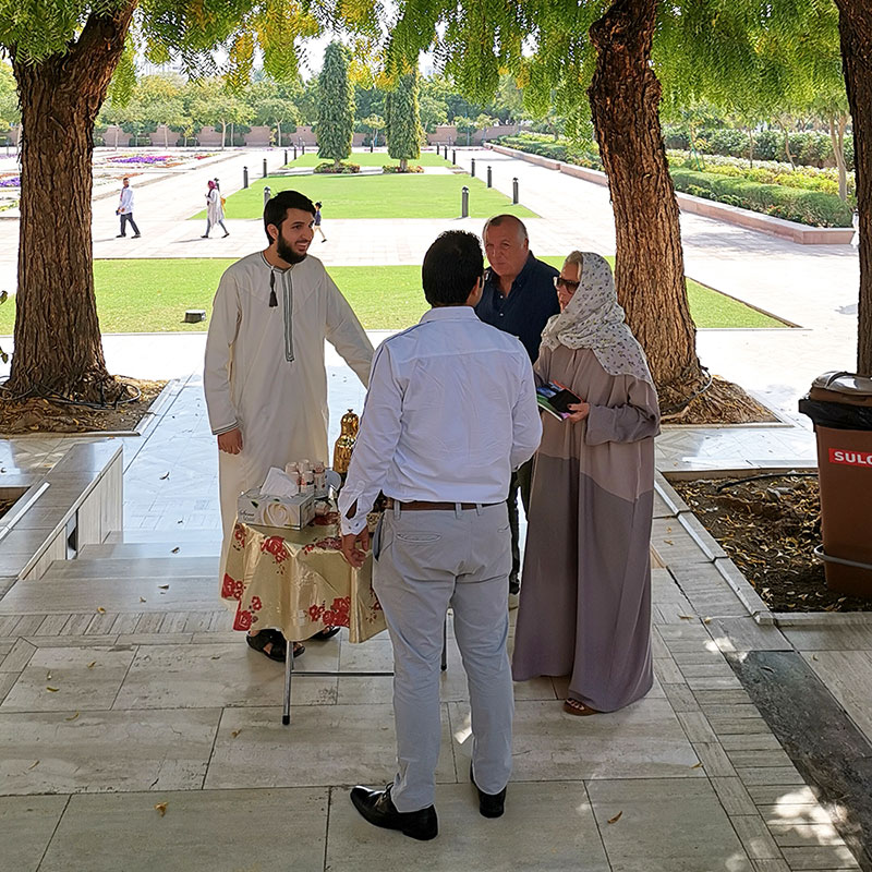 A mosque tour guide talks to visitors about Islam