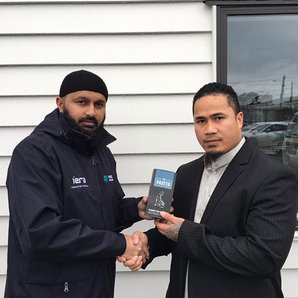 A new Muslim in New Zealand receives his Learn to pray pack from Tenfold gifted by the Muslim community in New Zealand