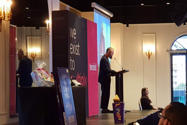 Mohamad Khodr on stage speaking at the Tenfold Fundraising Dinner in 2018